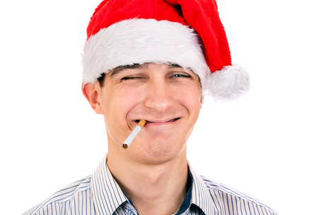 Young Man in Santa Hat with Cigarette on the White Background closeup