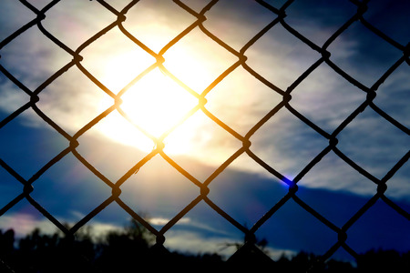 Sun and Sky through Wire Netting closeup