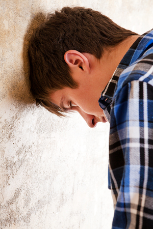 Sad Young Man by the Old Wall closeup Stock Photo