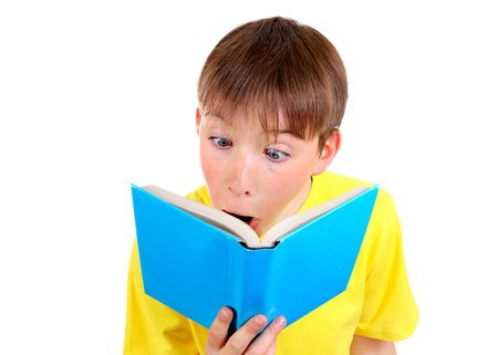 Surprised Kid with a Book on the White Background closeup