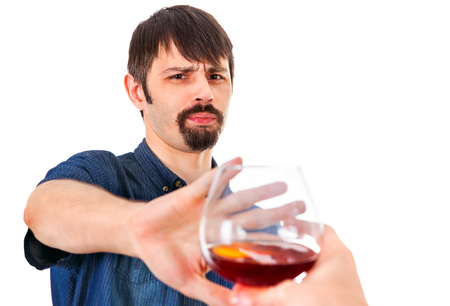 Man refuse Glass of Brandy on the White Background Imagens