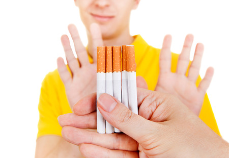 Young Man refuse Cigarettes Isolated on the White Background