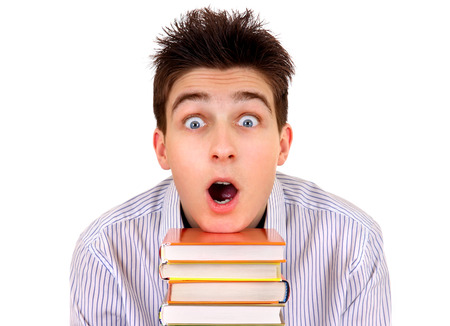 Shocked Student with a Books Isolated on the White Background