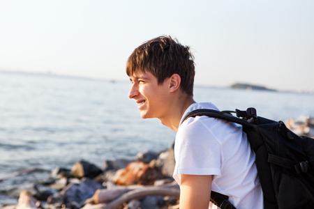 Cheerful Young Man at the Seaside Banco de Imagens