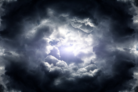 Hole in the Dark and Dramatic Storm Clouds Stock Photo