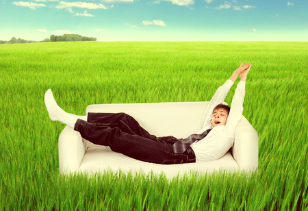 Toned Photo of Teenager sleep on the Couch in the Summer Field