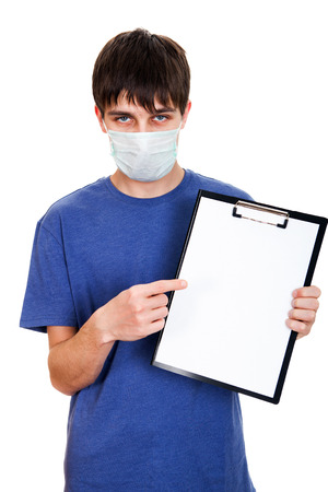 Sad Young Man in Flu Mask showing empty Clipboard on the White Background