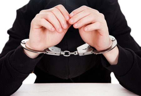 Person in Handcuffs on the Table closeup
