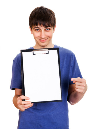 Cheerful Young Man showing empty Clipboard on the White Background