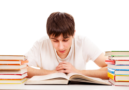 Student read a Book on the School Desk on the White Background