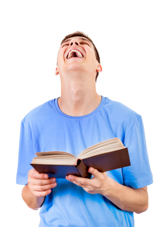Happy Young Man with a Book Laughing on the White Background Stock Photo