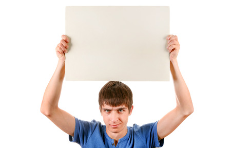 Annoyed Young Man with Blank Board Isolated on the White Background