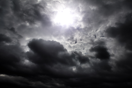 Light in the Dark and Dramatic Storm Clouds Фото со стока