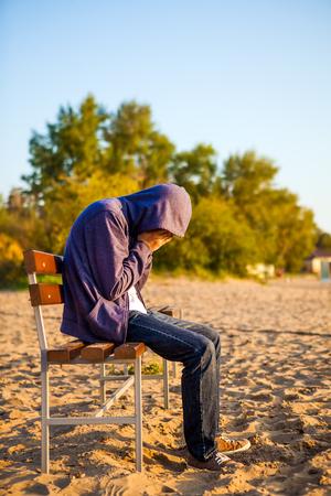 Sad Man sit on the Bench outdoor