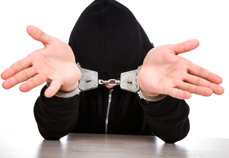 Man in Handcuffs shows a Palms on the White Background Stock Photo