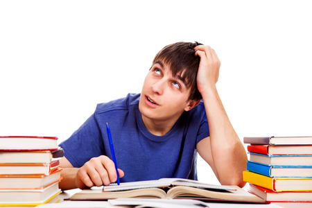 Student with a Books is Dreaming on the White Background Stock Photo