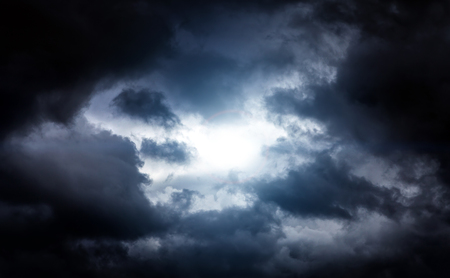 Light in the Dark and Dramatic Storm Clouds Archivio Fotografico