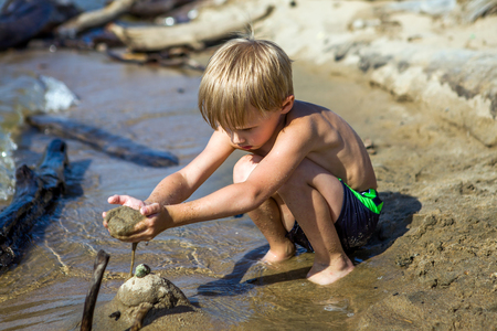 Kid Playing in the Sand on the Summer Beach