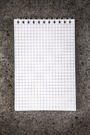 Notepad on the Grunge Metal Background closeup