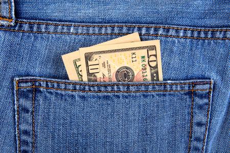 Dollari nella tasca dei jeans primo piano Archivio Fotografico