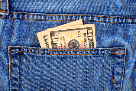 Dollars in the Pocket of the Jeans closeup 免版税图像