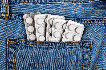 Many Pills in the Jeans Pocket closeup