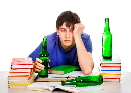 Tired Student with a Beer on the White Background Imagens