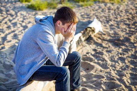 Sad Young Man close the Face outdoor