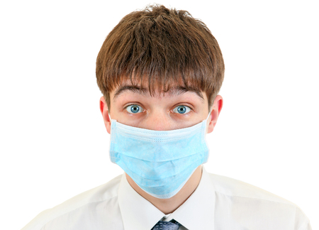Young Man in Flu Mask on the White Background Stock Photo