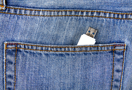 USB Flash Drive in the Jeans Pocket closeup