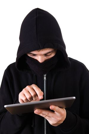 Hacker with a Tablet Computer on the White Background 版權商用圖片