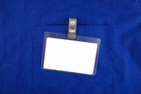 Blank Badge on the Blue Shirt Pocket closeup Stock Photo