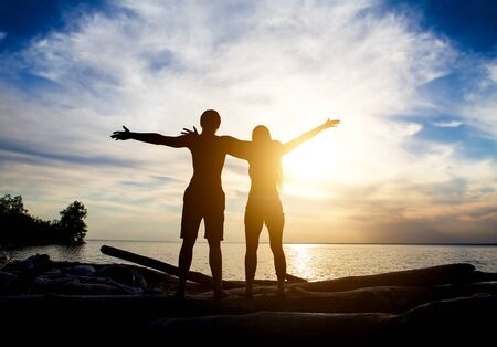 Happy Couple Silhouette with Hands Up on the Sunset Background Reklamní fotografie