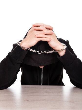 Man in Handcuffs on the White Background