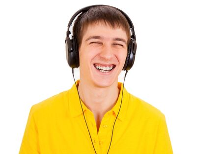 Cheerful Young Man in Headphones listen to the Music on the White Background