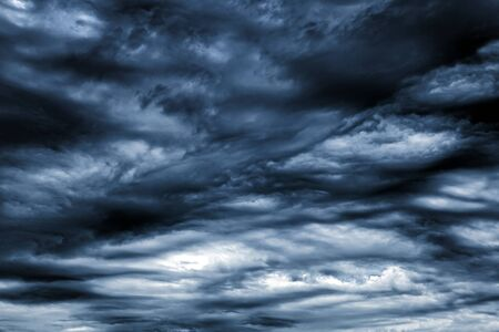 Toned Photo of the Dark and Dramatic Storm Clouds Area Background