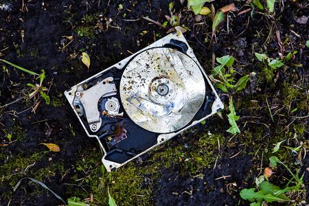 Crushed Hard Disk Drive on the Dirty Ground closeup Stock fotó