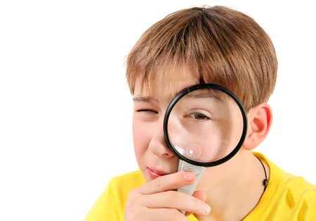 Curious Kid with Magnifying Glass Isolated on the White Background Stock fotó