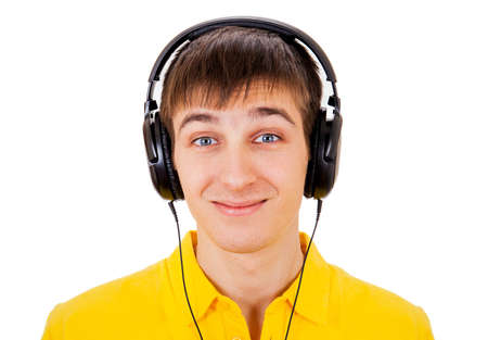 Young Man in Headphones listen to the Music on the White Background closeup Stockfoto
