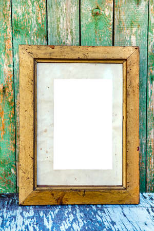 Old Wooden Frame with Empty Paper on the Weathered Paint Planks Background