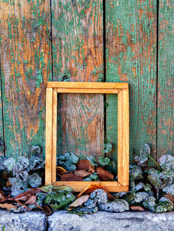 Old Wooden Frame on the Weathered Paint Planks Background