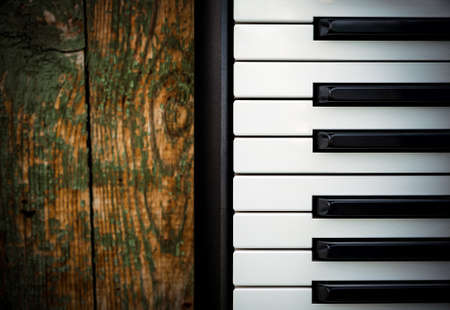Piano Keyboard on the Old Wooden Planks Background closeup 版權商用圖片