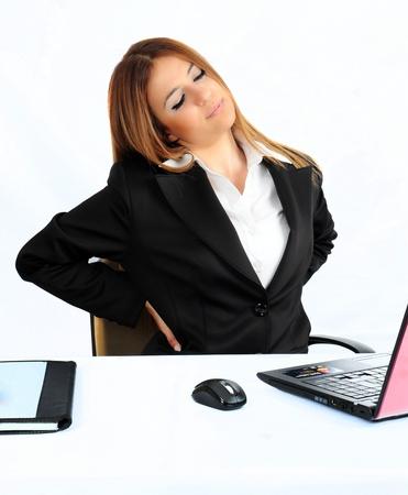 donna d'affari in vita dolorante