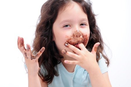 dirty girl: child eat chocolate Stock Photo