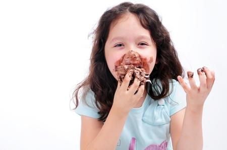 bambino mangia cioccolato Archivio Fotografico