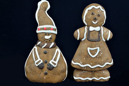 Two Gingerbread Cookies,  close up, isolated on black photo