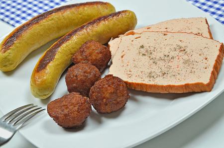 grilled sausages: Grilled Sausages, Leberk�se and Meatballs on Plate