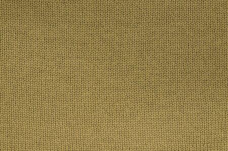 ochre: ochre knitted background pattern Stock Photo
