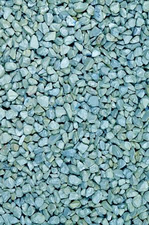 close up of light blue pebbles, macro, full frame, vertical,  full frame