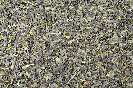 sencha tea: close up of green tea Sencha leaflets, detail, macro, full frame, horizontal